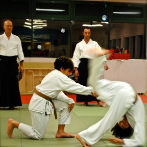 Justin Couvignou (senior assistant instructor) and Elliot Couvignou (junior assistant instructor) during their youth class belt test in December 2011.